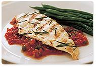 Grilled chicken with spicy tomato and caper sauce