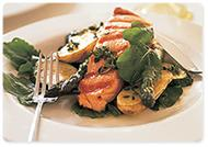 Seared salmon with roasted vegetables and rocket